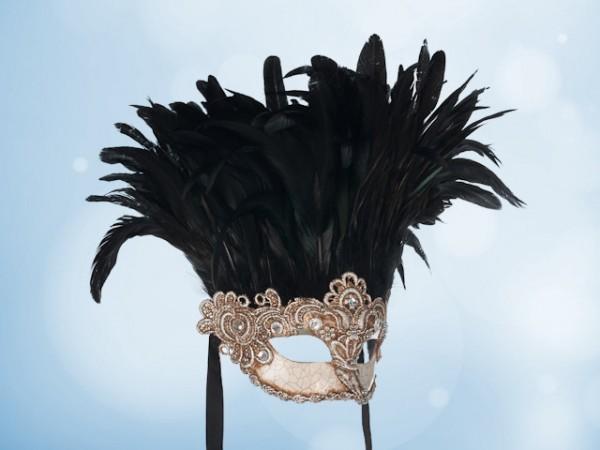 Masque de bal argenté à plumes noires